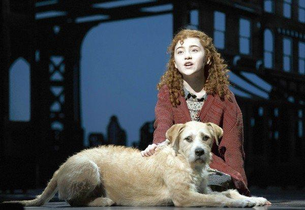 "Broadway's new Annie, Lilla Crawford, says of her character: ""She's not exactly mean, but she's tough."" Sandy is a rescue dog."