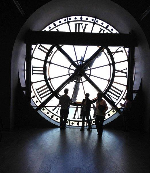 View from the beautiful atrium of the D'Orsay Museum in Paris, through the clock, across the Seine. I used my s4 iPhone. The magnificent structure is the renovated train station along the Seine. Taken Sept. 2012.