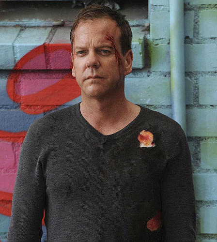 Eight very long days in the life of Jack Bauer (Kiefer Sutherland) came to an end with the super-agent on the run, shot by a colleague -- at his own behest -- helping expose nefarious presidential dealings and saving the world yet again. So, you know, just another day.