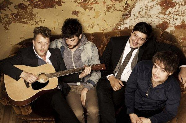 Members of the band Mumford & Sons. from left to right, Ted Dwane, Winston Marshall, Marcus Mumford and Ben Lovett