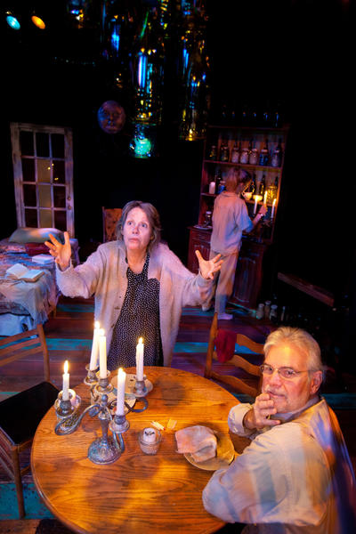 "Robin Olson and Joe Candelora star with Ginger Lee McDermott (pictured in the background) in Mad Cow Theatre's ""Road to Mecca."""