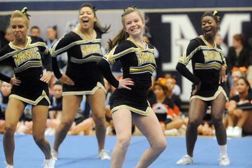 Peyton Fuller, second from right, and other members of the Mt. Hebron cheerleaders perform their routine during the Howard County Fall Cheerleading Championships at Marriotts Ridge High School.