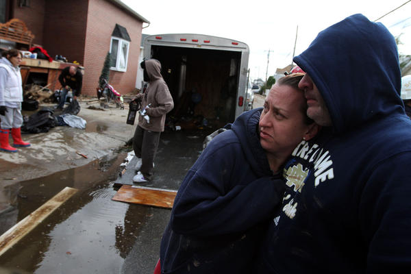 Hilary and James Bowden embrace while helping James' brother with his destroyed home on Staten Island.
