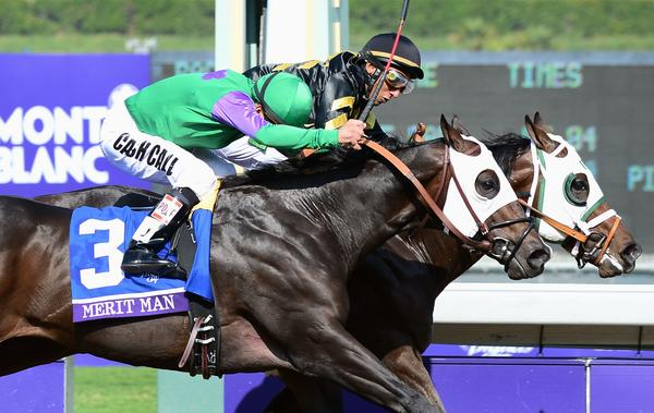 Jockey Rajiv Maragh guides Hightail to a victory by a nose over Merit Man and jockey Patrick Valenzuela in the Breeders' Cup Juvenile Sprint on Friday at Santa Anita Park.