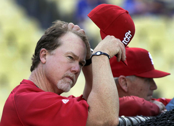Cardinals hitting coach Mark McGwire watches batting practice before a game at Dodger Stadium.