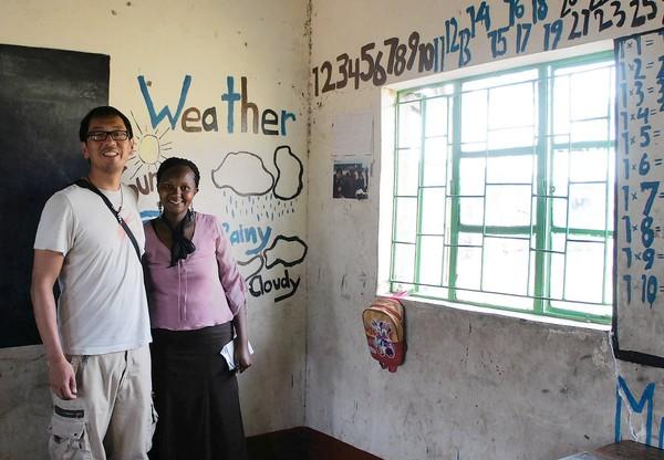 Jun Shen, left, and Glady Klu in Klu's second-grade classroom at Oloolaimutia School in Maasai Mara, Kenya.