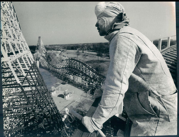 High above Marriott's Great America in Gurnee, Ill., Jerry Stockdale takes a break from painting the American Eagle roller coaster on April 16, 1981. At least 9,000 gallons of white paint were needed to spruce up the 127-foot tall ride, which took more than 20,000 hours to construct.