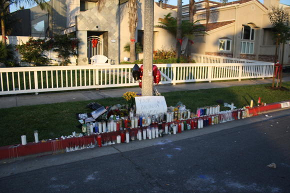 A memorial for Mitch Lucker lines the street where he crashed his motorcycle in Huntington Beach.