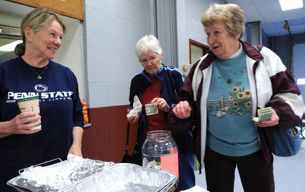 Volunteer JoAnn Seren of Durham, left, thanks guests for their donations to the fire department. At center is Gloria Sebring of Riegelsville and at right is Beverly Macaluso of Raubsville. They have no power at home.