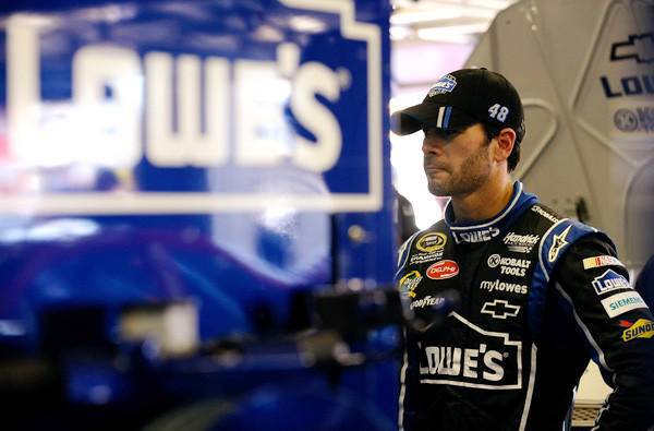 NASCAR driver Jimmie Johnson waits in the garage during practice at Texas Motor Speedway on Friday.