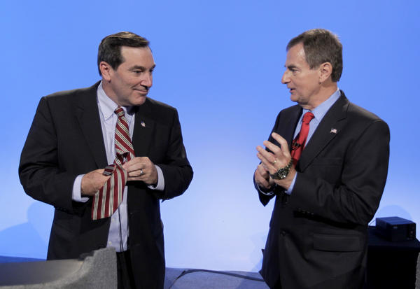 Indiana Senate candidates Democrat Joe Donnelly, left, and Republican Richard Mourdock talk after participating in a debate in Indianapolis.