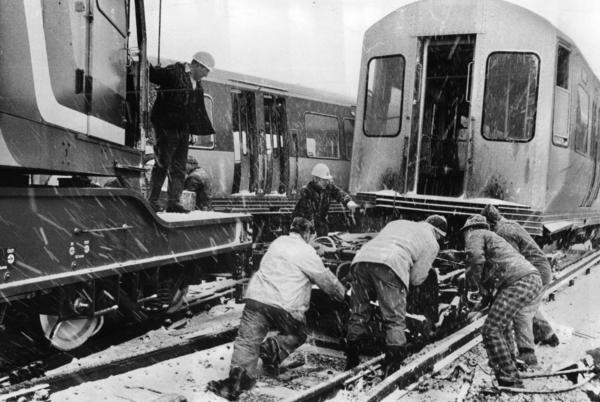 In a driving snow, workmen strive to clear tracks after crash on CTA's Lake Street rapid transit line west of Harlem station on April 2, 1975.