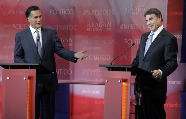 Former Massachusetts Gov. Mitt Romney, left, and Texas Gov. Rick Perry attacked each other's record for creating jobs in their states during a Republican presidential debate.