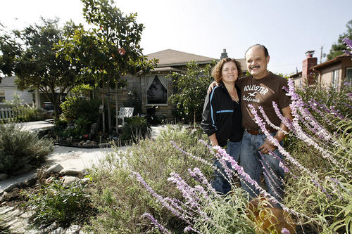 Juan Jimenez and his wife Angelica in their front yard on the 300 block of Keystone Ave. in Burbank on Friday, Nov. 2, 2012.  Jimenez planted drought-tolerant plants and added concrete in his front yard to save money on water use.