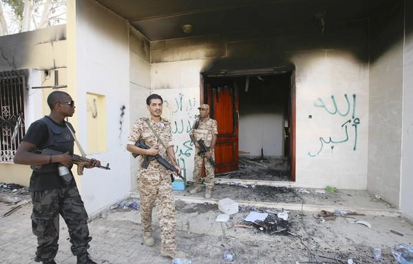 Libyan military guards inspect one of the buildings at the U.S. diplomatic compound in Benghazi three days after the attack that killed four Americans.