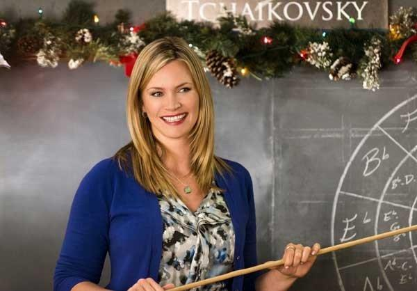 "A music teacher (Natasha Henstridge) must compete for her job when her New York high school is merged with another in the new TV movie ""Christmas Song"" at 8 p.m. on Hallmark."