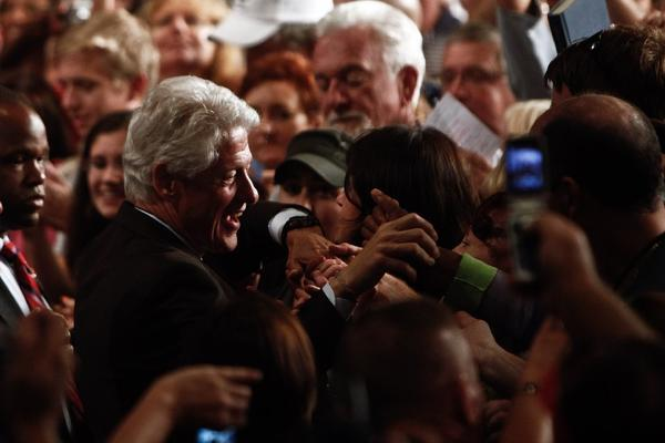 Former President Clinton greets supporters after speaking in support of President Obama during a campaign event in Fort Myers, Fla.
