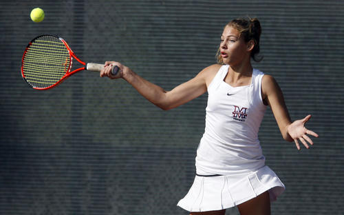 Maranatha's Hailey McNall  swings at the ball during a singles match against North at Occidental College in Los Angeles on Friday, November 2, 2012.