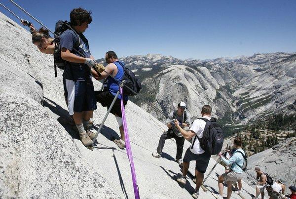 Half Dome attracts flocks of climbers, who will be able to try to reserve a spot via lottery through the end of this month.