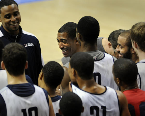 UConn men's basketball head coach Kevin Ollie shares a light moment with the team at the end of practice Oct. 31, the day before their first exhibition game.