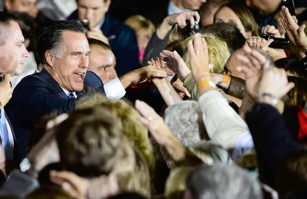 Republican presidential candidate Mitt Romney campaigns in Wisconsin. Both his and President Obama's campaigns have enough cash on hand to stage huge last-minute ad blitzes.
