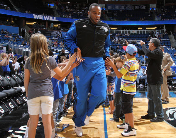 Orlando forward Glen Davis makes his way to the court for pregame warmups before the Magic's regular season tip-off against the Denver Nuggets in Orlando, Fla. Friday, November 02, 2012.