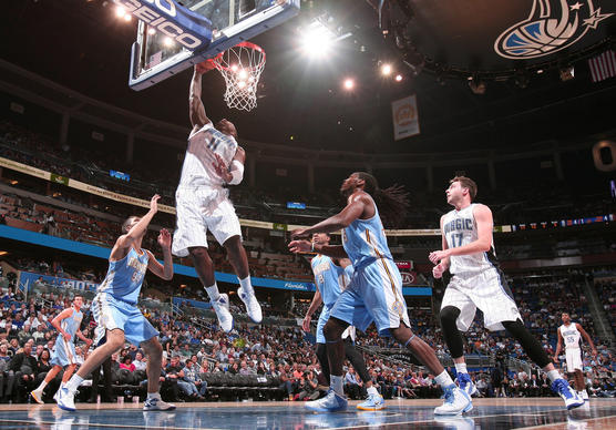 Orlando forward Glen Davis (11) dunks during the second quarter of the Magic's regular season opener against the Denver Nuggets in Orlando, Fla. Friday, November 02, 2012.