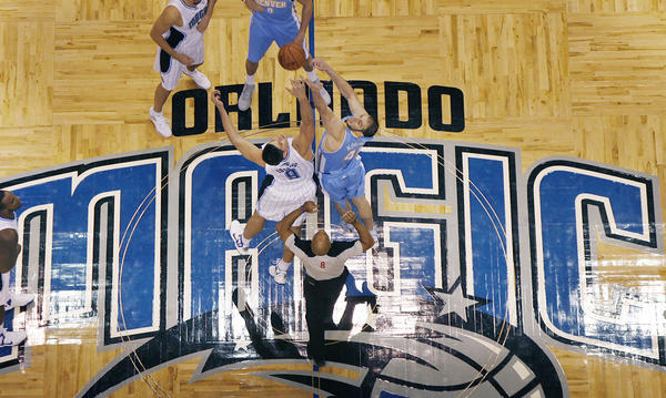 Orlando center Nikola Vucevic (9) and Denver center Kosta Koufos (41) jump for the opening tip during the Denver Nuggets at Orlando Magic NBA game at the Amway Center on Friday, November 2, 2012.