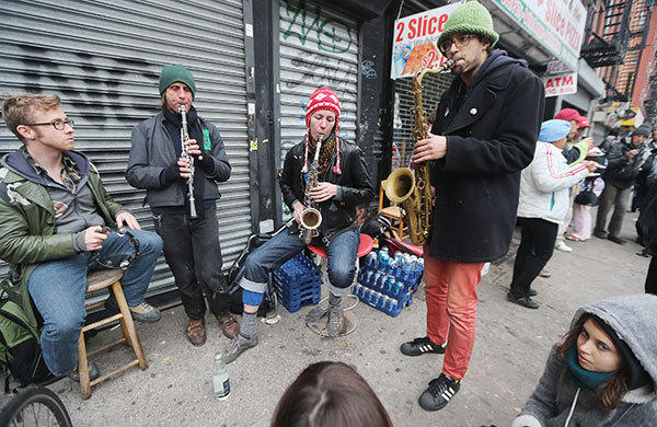 Members of the Rude Mechanical Orchestra perform an impromptu jam session on the Avenue C shortly after power was restored in Manhattan's East Village on November 2, 2012 in New York City. Millions of customers in New Jersey and New York remain without power following Superstorm Sandy as colder weather approaches.