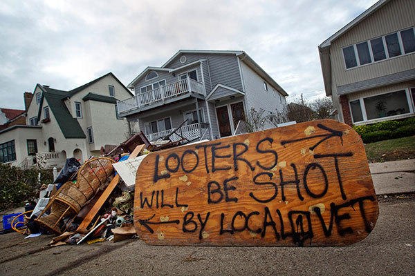 A sign is seen outside a home in Long Beach, New York November 2, 2012, warning looters will be shot.