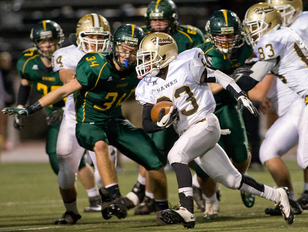 Bethlehem Catholic's Kyle Arrington (23) turns upfield pursued by Central Catholic's Kevin Kern (34) in the first half of their game at J. Birney Crumb Stadium in Allentown on Friday night.