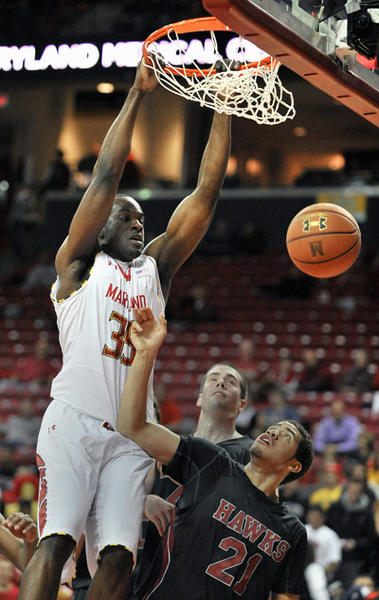 Maryland's James Padgett dunks over IUP's Devon Cottrell during the first half of their exhibition game at Comcast Center.