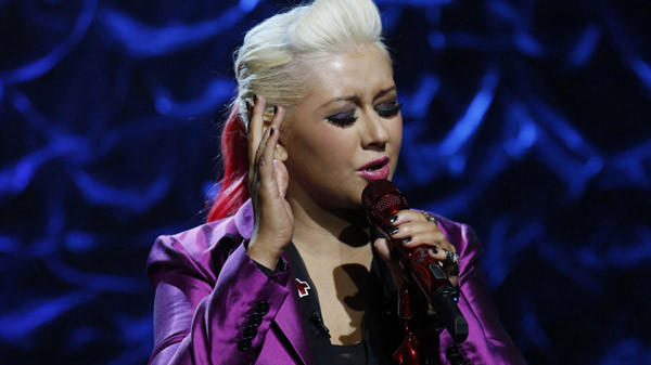 "Christina Aguilera sings during the ""Hurricane Sandy: Coming Together"" benefit concert."