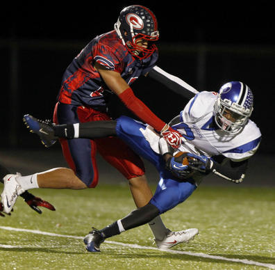 York's Tywuan Lewis catches a 41-yard pass over Grafton's Jesse Santiago for a touchdown during the fourth quarter of Friday's game.