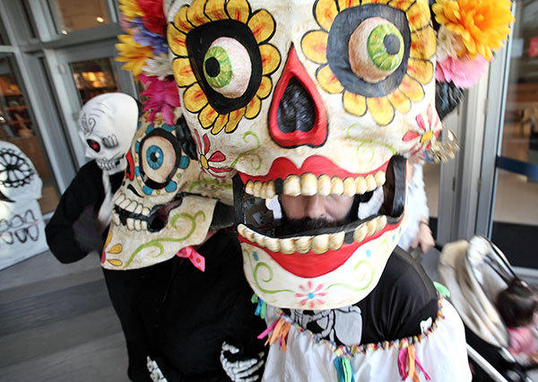 People attend the Day of the Dead processional at Fort Lauderdale Museum of Art Theatre on November 2, 2012.
