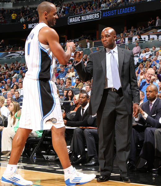 Orlando Magic head coach Jacque Vaughn fist pumps with Arron Afflalo (4) at the conclusion of their 89-102 season opening win over the Denver Nuggets in Orlando, Fla.