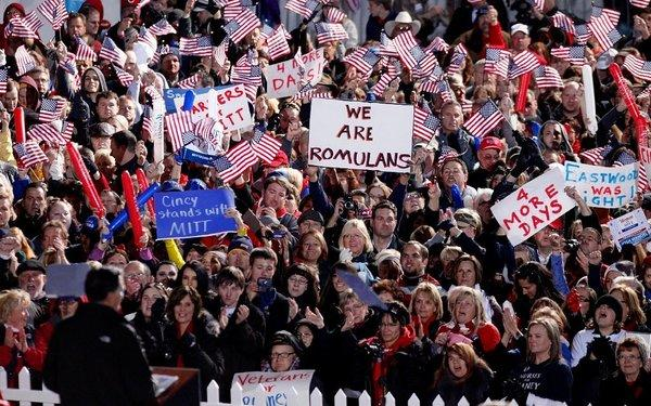 Supporters cheer at a campaign event for Mitt Romney and Paul Ryan in West Chester, Ohio.
