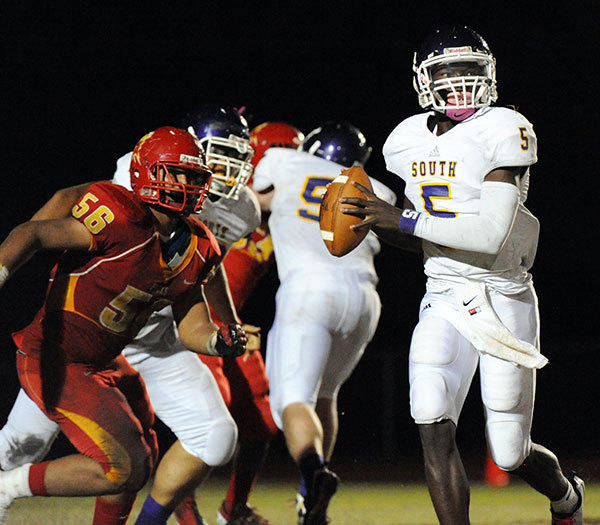 John Franklin of South Plantation High looks to pass against Deerfield Beach High in the second half.