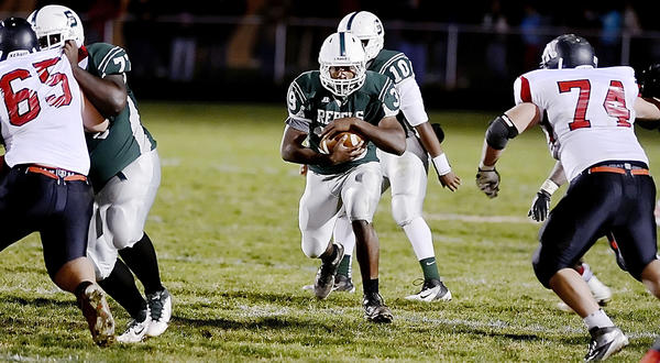 South Hagerstown's Isiaha Smith breaks the 2,000-yard single-season rushing barrier with this run in the fourth quarter against North Hagerstown during Friday night's Hagerstown Gridiron Championship Classic at School Stadium.