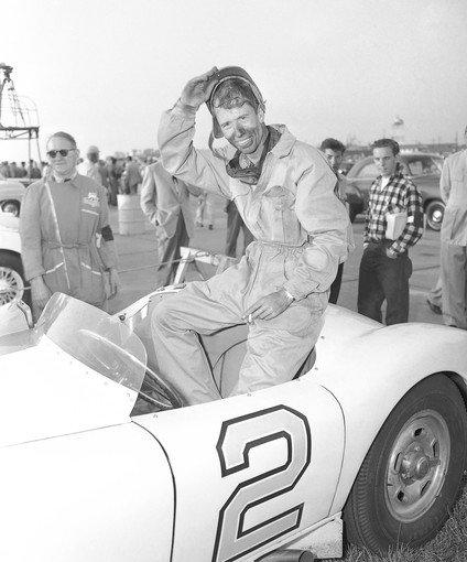 John Fitch removes his helmet after winning the main race at the Sowega National Sports Car Races in Albany, Ga., in October 1952 in a Cunningham speedster.