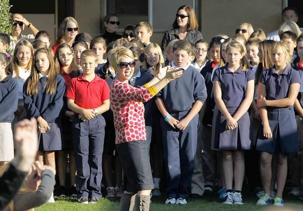 Carden Hall music teacher Mrs.Laurel Wicke leads students in song as the school celebrated its 50th birthday on campus Friday morning.