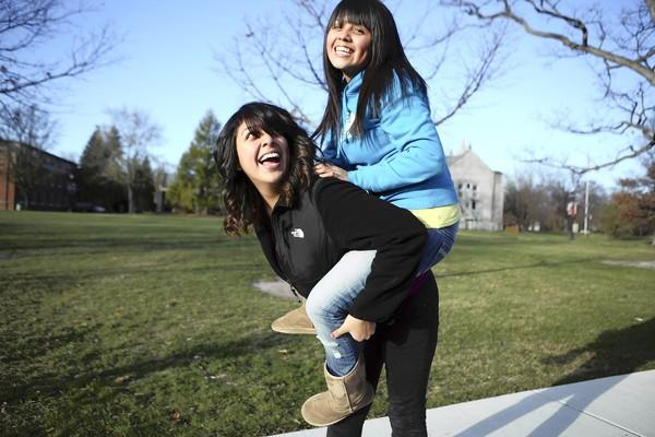 Leticia Gelacio, 19, left, and her sister, Jasmine, 18, are students at Lake Forest College. The graduates of Hancock High School, on the Southwest Side of Chicago, received assistance from the Network for College Success, a partnership between the University of Chicago and Chicago Public Schools.