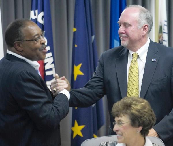 Former acting Metra chairman Larry Huggins, left, congratulates Brad O'Halloran after O'Halloran was elected Metra's chairman Friday.