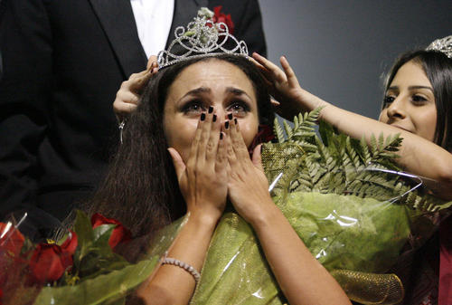 Glendale's Preni Gharibian, right, crowns Arsineh Sarkisian as the homecoming queen during halftime at Glendale High School on Friday, November 2, 2012.