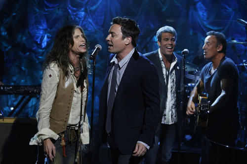 From left, Steven Tyler, Jimmy Fallon, Mark Rivera and Bruce Springsteen perform.
