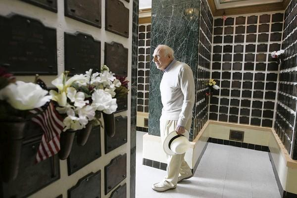 Retired Army Col. Dick Littlestone walks in the small columbarium at the Los Angeles National Cemetery. He is pushing a proposal for a much bigger such facility nearby on the West Los Angeles VA campus.