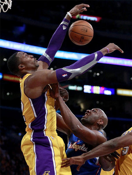 The Lakers' Dwight Howard blocks Lamar Odom's shot in the second half of Friday's game against the Clippers at Staples Center.