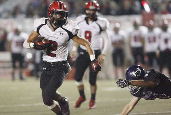 "Glendale's Christian Osorio scored a rushing touchdown to help his Nitros earn the right to ring the ""Victory Bell."""