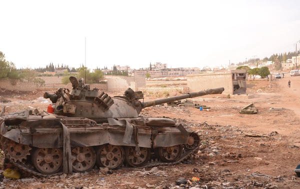 A Syrian army tank is seen in the Khan al-Assal area after clashes between Free Syrian Army fighters and forces loyal to Syria's President Bashar al-Assad near Aleppo.