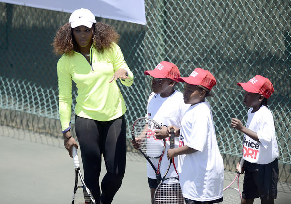 Serena Williams works with children during a clinic at the Arthur Ashe Tennis Centre in the South African township of Soweto on Saturday.